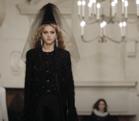 A model wearing a Gnome's hat for the Chanel Fashion show.